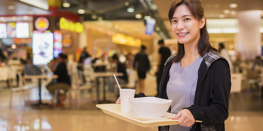 woman holding food tray