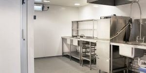A kitchen with BioClad hygienic wall cladding